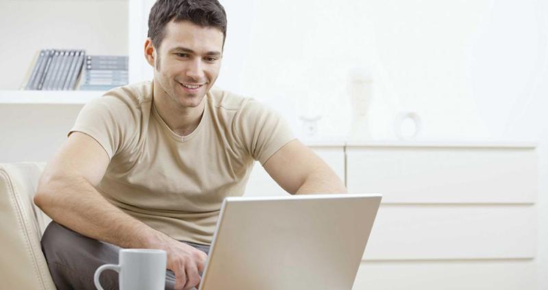 smiling-man-at-laptop-for-website